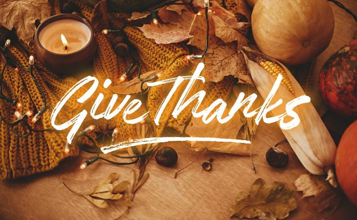 Thanksgiving decorated background with give thanks text.