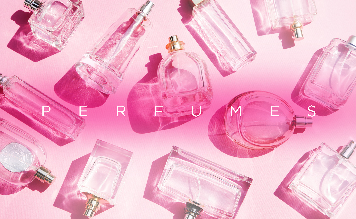 Perfumes with a pink background.