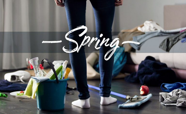 Spring with a person standing in the middle of a messy room and cleaning supplies.