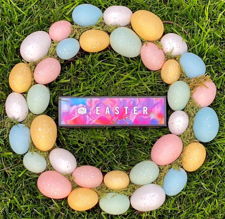 Easter Fragrance Oil Set with Easter egg wreath around it in a circle // in green grass.