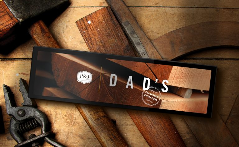 """A """"Dad's Set"""" of fragrance oils on brown wood background."""