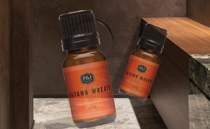 P&J Trading Autumn Wreath Fragrance Oils with orange labels photoshopped onto a dark shower.