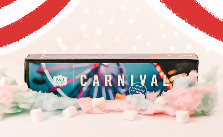 Carnival collection of fragrances and marshmallows against a white background.